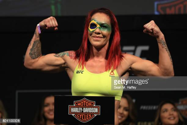 Cris Cyborg of Brazil poses for fans on the scale during the UFC 214 weighin at Honda Center on July 28 2017 in Anaheim California Cyborg will fight...