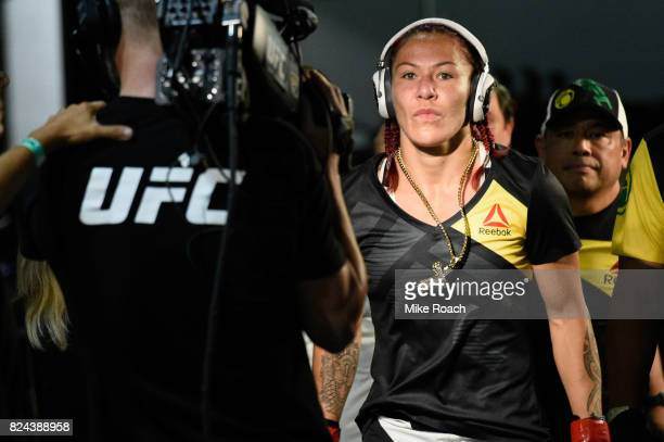 Cris Cyborg of Brazil prepares to enter the Octagon prior to her bout against Tonya Evinger during the UFC 214 event at Honda Center on July 29 2017...