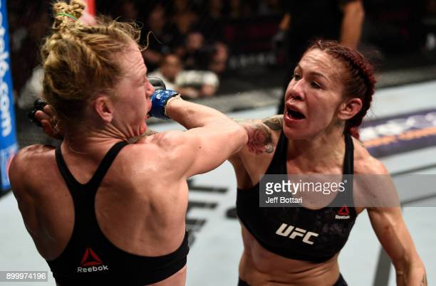 Cris Cyborg of Brazil punches Holly Holm in their women's featherweight bout during the UFC 219 event inside TMobile Arena on December 30 2017 in Las...