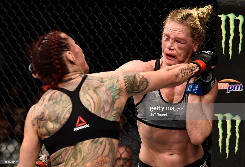 Cris Cyborg of Brazil punches Holly Holm in their women's featherweight bout during the UFC 219 event inside T-Mobile Arena on December 30, 2017 in Las Vegas, Nevada.