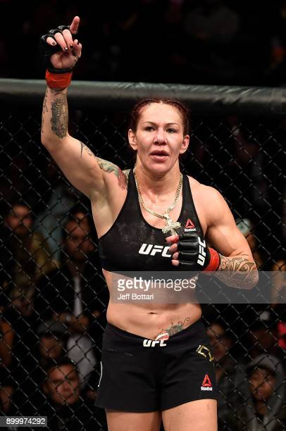 Cris Cyborg of Brazil reacts after the conclusion of her women's featherweight bout against Holly Holm during the UFC 219 event inside TMobile Arena...
