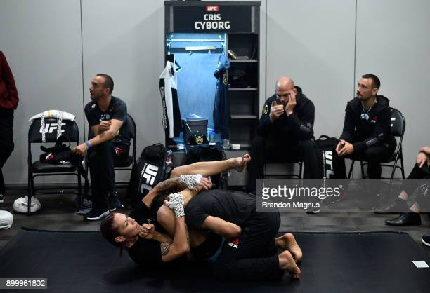 Cris Cyborg of Brazil warms up prior to her women's featherweight title defense against Holly Holm during the UFC 219 event inside TMobile Arena on...
