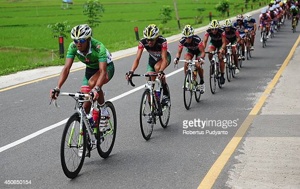 Cris Joven of Team 7 Eleven Roadbike Phillipine leads the peleton during stage 9 of the 2014 Tour de Singkarak from Pesisir Selatan to Padang City...