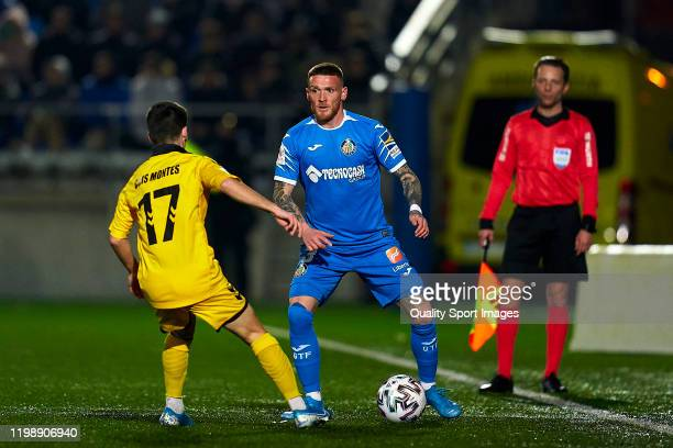 Cris Montes of CF Badalona competes for the ball with Vitorino Antunes of Getafe during the Copa del Rey First Round match between CF Badalona and...