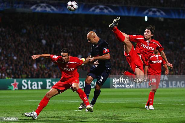 Cris of Lyon is under pressure from Dario Dainelli and Riccardo Montolivo during the UEFA Champions League Group E match between Lyon and Fiorentina...