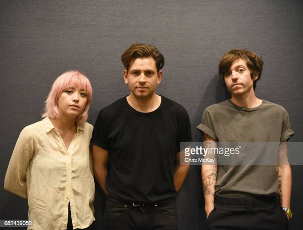 Crisanta Baker, Matt Lowell, and Sam Stewart of Lo Moon pose for portraits backstage at the Shaky Knees Music Festival at Centennial Olympic Park on...