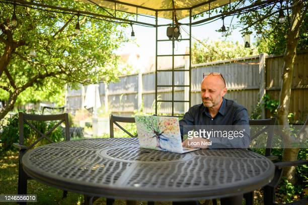 Crisis Volunteer David Whiting sits in his garden, where he sometimes responds to texters for the crisis text service Shout 85258 on June 01, 2020 in...