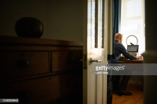 Crisis Volunteer David Whiting sits in his office where he usually responds to texters for the crisis text service Shout 85258 on June 01 2020 at his...