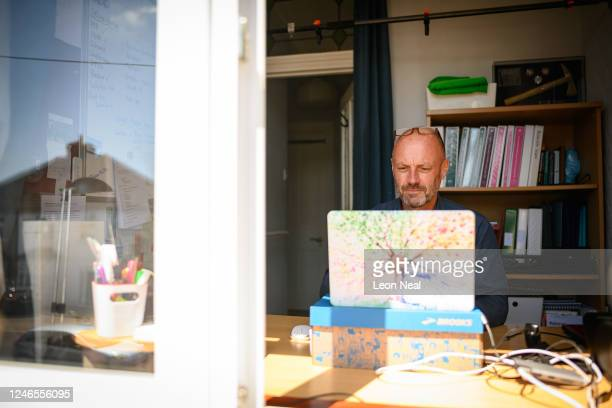Crisis Volunteer David Whiting sits in his office, where he usually responds to texters for the crisis text service Shout 85258 on June 01, 2020 at...