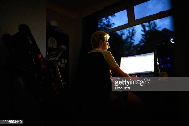 Crisis Volunteer Florian Walter sits at the computer where he works his shifts for the crisis text service Shout 85258 on June 04, 2020 in...
