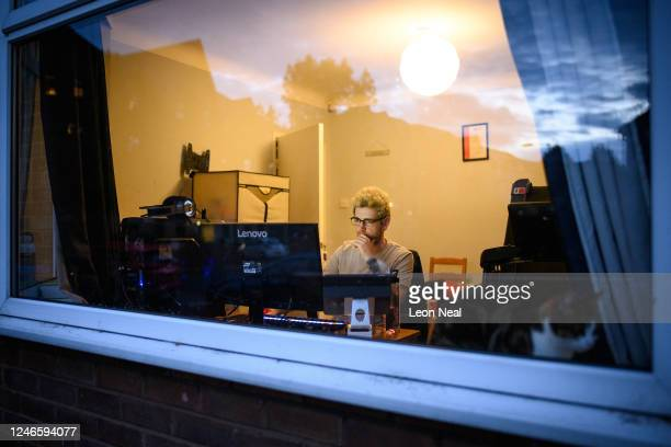 Crisis Volunteer Florian Walter sits at the computer where he works his shifts for the crisis text service Shout 85258, on June 04, 2020 in...