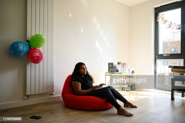Crisis Volunteer Sapna Chandaria sits on a beanbag in her new flat where she logs in for her shifts with the crisis text service Shout 85258 on June...