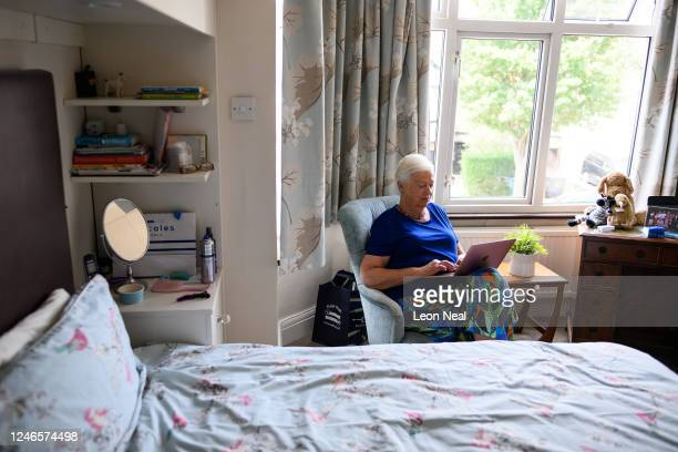 Crisis Volunteer Sheila Angel sits in her bedroom where she usually logs in for her work with the crisis text service Shout 85258 on June 02 2020 in...