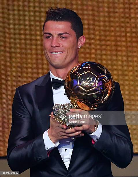 Crisitano Ronaldo of Portugal receives the FIFA Ballon d'Or 2013 trophy at the Kongresshalle on January 13 2014 in Zurich Switzerland