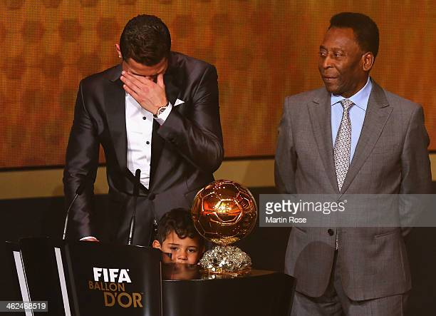 Crisitano Ronaldo of Portugal with his son Cristiano Ronaldo Jr receives the FIFA Ballon d'Or 2013 trophy at the Kongresshalle on January 13 2014 in...