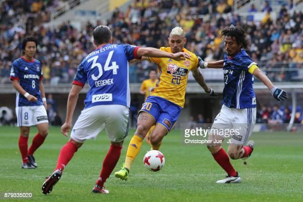 Crislan of Vegalta Sendai controls the ball under pressure of Yuji Nakazawa and Milos Degenek of Yokohama FMarinos during the JLeague J1 match...