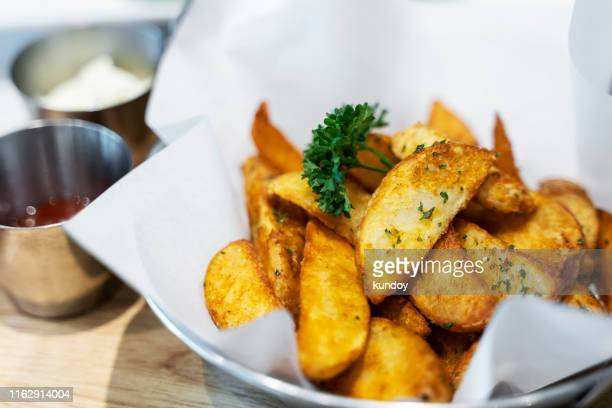 crisp golden deep fried french fries hot potatoes frying and ready to be eaten - fried stock pictures, royalty-free photos & images