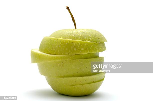 crisp green apple sliced jigsaw covered in water droplets