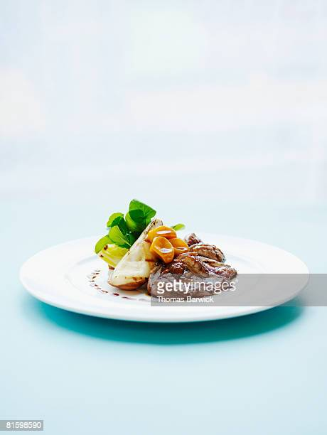 crisp liberty duck breast, braised endive, watercress and grilled pears.  - plate stock pictures, royalty-free photos & images