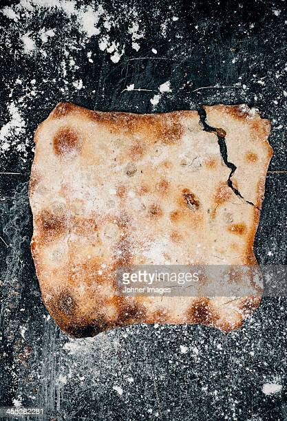 Crispbread with onion and white wine on metal sheet, directly above