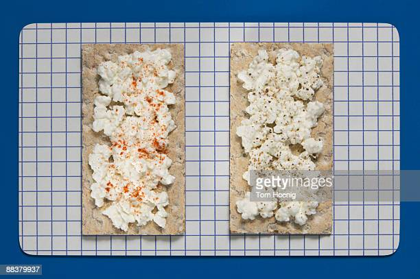 Crispbread with soft cheese, overhead view