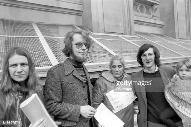 Crispin Aubrey holding his threeyearold daughter Kate and fellow journalist Duncan Campbell outside the Home Office the day after their release on...