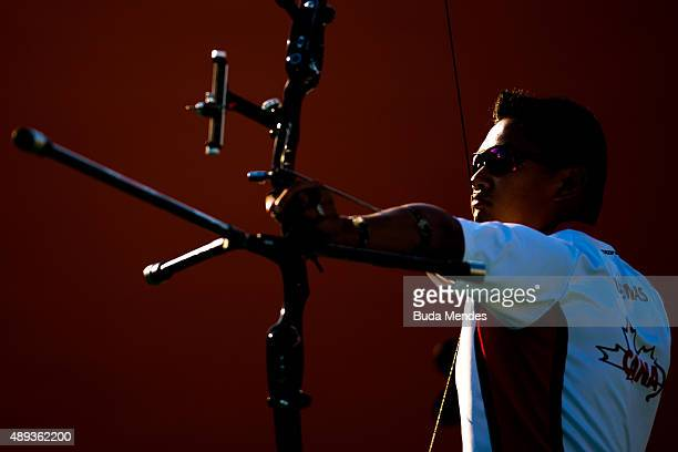 Crispin Duenas of Canada prepares to shoot during the Archery test event for the Rio 2016 Olympic Games at Sapucai Sambodrome on September 20 2015 in...