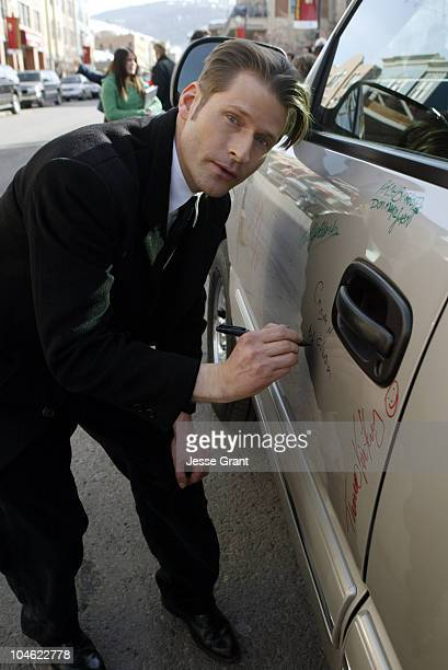 Crispin Glover autographs a 2005 Chevrolet Silverado Pickup which General Motors will donate to the National Ability Center, a local charity...