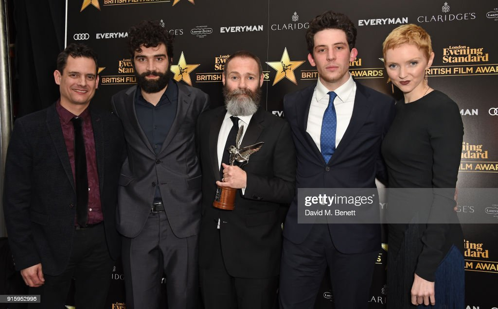 Crispin Lilly, Alec Secareanu, Francis Lee; Josh O'Connor and Lily Cole pose with the Breakthrough of the Year award for 'God's Own Country' at the London Evening Standard British Film Awards 2018 at Claridge's Hotel on February 8, 2018 in London, England.