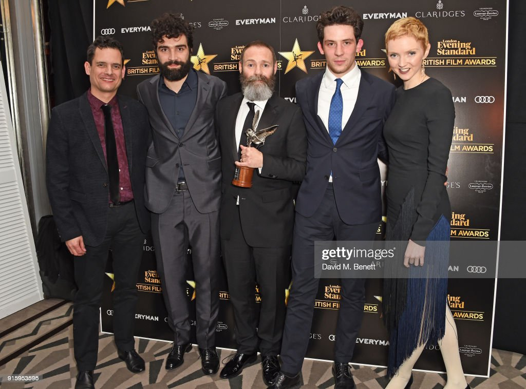 Crispin Lilly, Alec Secareanu, Francis Lee, Josh O'Connor and Lily Cole pose with the Breakthrough of the Year award for 'God's Own Country' at the London Evening Standard British Film Awards 2018 at Claridge's Hotel on February 8, 2018 in London, England.