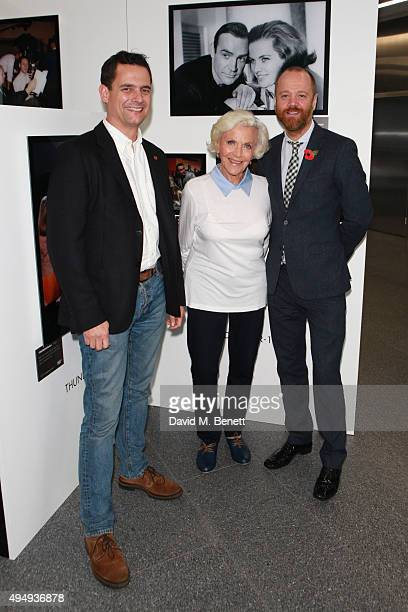 Crispin Lilly CEO of Everyman Cinema Honor Blackman and John Harvey Head of Major Gifts at The Stroke Association visit 'The Name's Bond' exhibition...