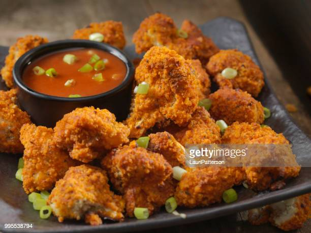 crispy baked buffalo wing cauliflower bites - fried stock pictures, royalty-free photos & images