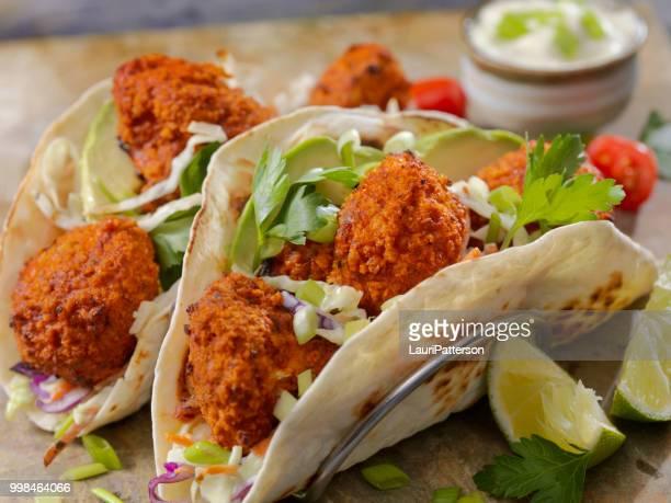 crispy baked buffalo wing cauliflower tacos - cauliflower stock pictures, royalty-free photos & images