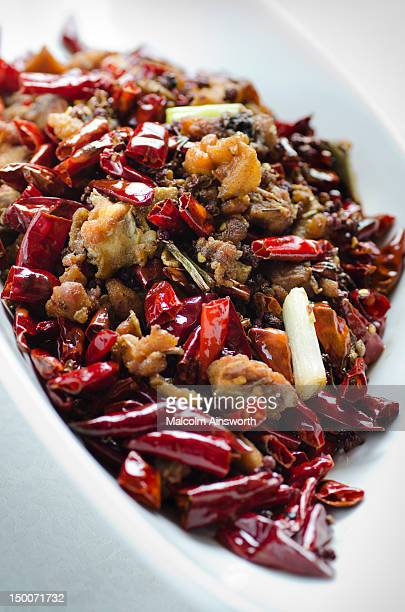 Crispy chicken dices with spicy dried red chillies
