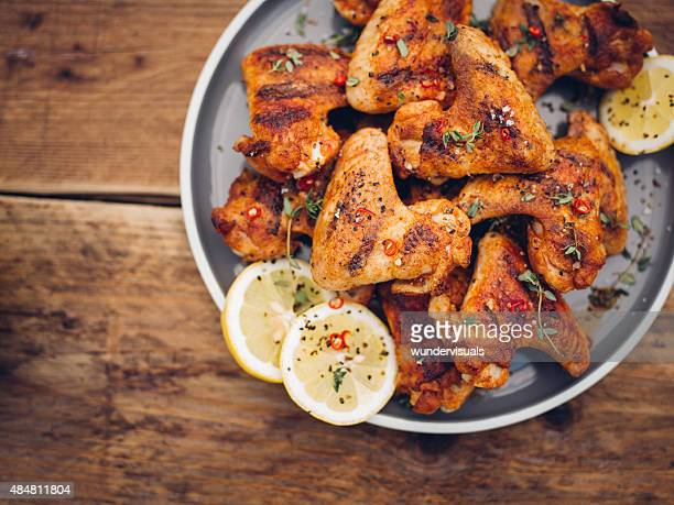 crispy chillie sprinkled chicken wings on a plate - chicken wings stock pictures, royalty-free photos & images