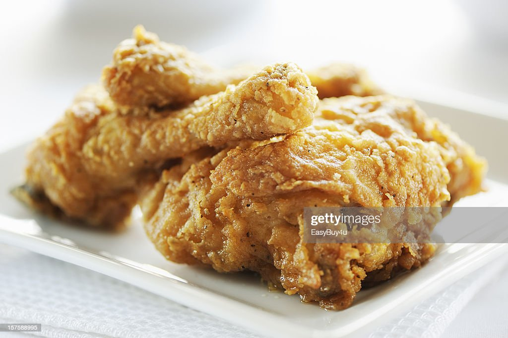 Crispy fried breast and legs from chicken : Stock Photo