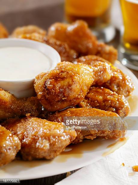 crispy honey garlic chicken wings and beer - breaded stock photos and pictures