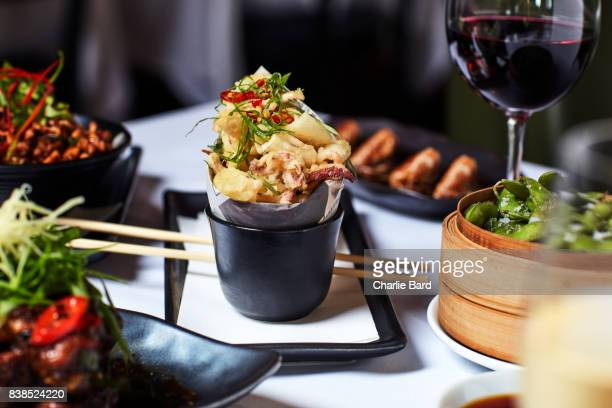crispy squid surrounded with other asian food - silver service stock pictures, royalty-free photos & images
