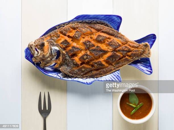Crispy whole flounder deepfried whole flounder topped with fresh basil leaves and chef's special chilitamarind sauce was photographed on Tuesday...
