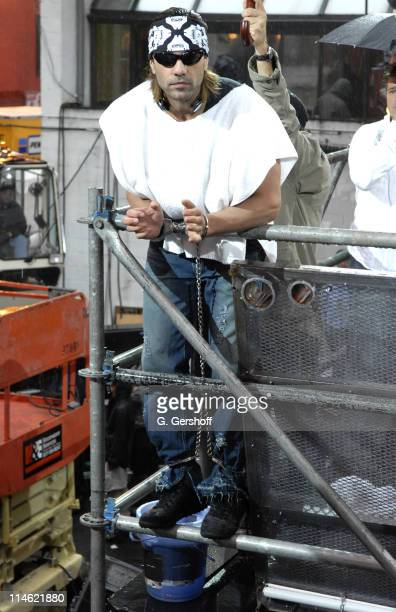 Criss Angel during Criss Angel Encased in a Concrete Block and Lifted 40 Feet Above Ground at Times Square in New York City New York United States