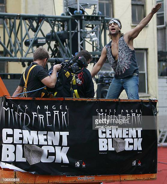 Criss Angel greets crowd of supporters after emerging from a cementencased block in which he had spent 24 hours shackled and bound suspended from a...