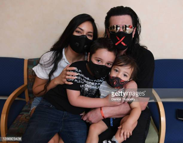 Criss Angel , his wife Shaunyl Benson with sons Johnny Crisstopher Sarantakos and Xristos Yanni Sarantakos attend the unveiling of a large scale...