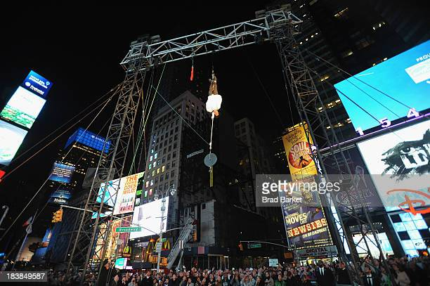 Criss Angel performs Double Straight Jacket Escape in the middle of Times Square for his new Spike TV series Criss Angel BeLIEve on October 9 2013 in...
