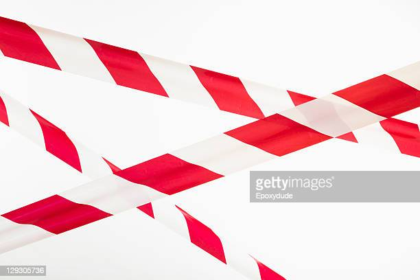 crisscrossed red and white striped cordon tape  - cordon boundary stock pictures, royalty-free photos & images