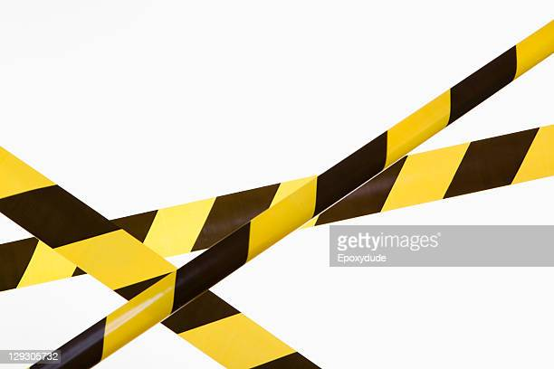 crisscrossed yellow and black striped cordon tape - verboten stock-fotos und bilder