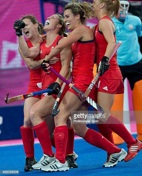 Crista Cullen of Great Britain celebrates along with teammates after scoring a goal against the Netherlands during the women's field hockey...