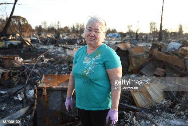 Crista Gatti poses for a photo at her burned home in the Coffey Park area of Santa Rosa California on October 20 2017 Residents are being allowed to...