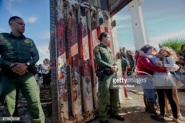 Cristal Brayan Ramirez Cervantes hugs Lucia Cervantes while daughters Brenda Karely and Ashley de la Torres Ramirez look on atthe US Mexico border...
