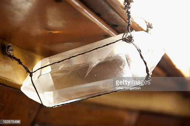 A cristal hanged in the cockpit of American sailor Reid Stowe's boat during1152 days at sea at the helm of his handbuilt weathered wooden 70 foot...