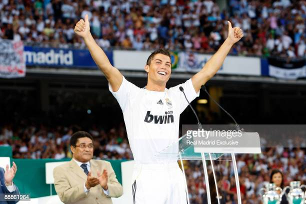 Cristano Ronaldo waves to fans during his official presentation at Santiago Bernabeu Stadium on July 6 2009 in Madrid Spain